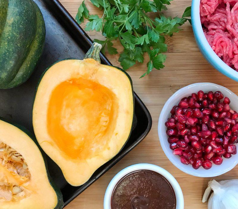 Roasted Acorn Squash with BBQ Beef & Pomegranate Arils via LizsHealthyTable.com #dinner #WinterSquash #GlutenFree