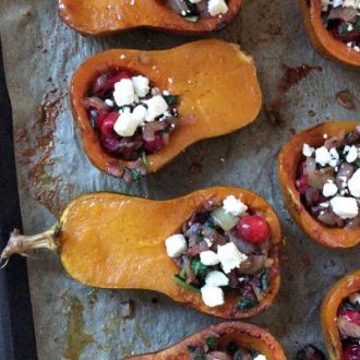 Honeynut Squash Stuffed with Caramelized Onion, Cranberries, Spinach and Bacon