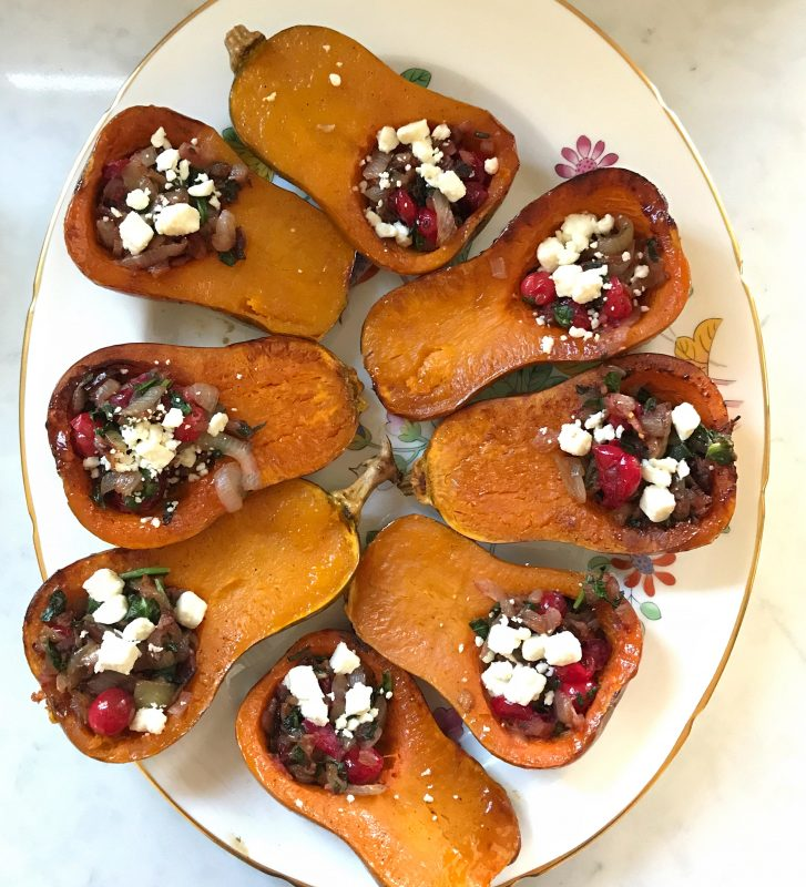 Honeynut Squash Stuffed with Caramelized Onion, Cranberries, Spinach and Bacon via LizsHealthyTable.com