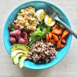Wild Rice Grain Bowl with Roasted Radishes, Carrots, Hard Boiled Eggs, and Chickpea Mash