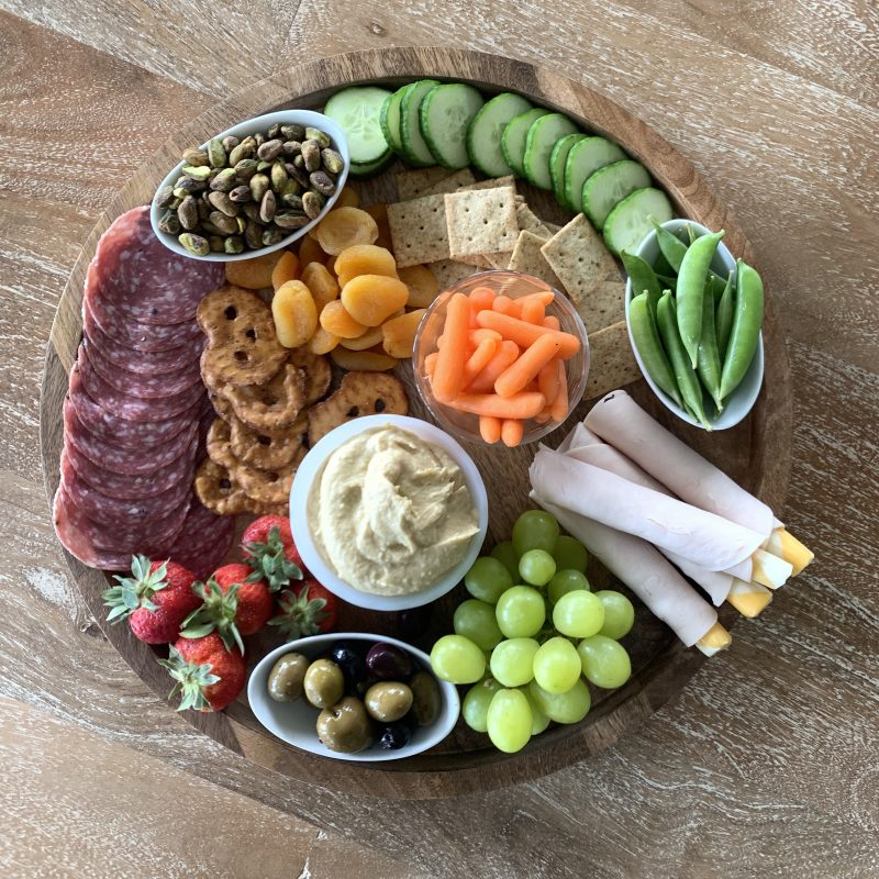 How to make a kid-friendly snack board via lizshealthytable.com #snackboard