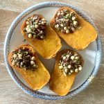 Honeynut Squash Stuffed with Mushrooms, Chickpeas, Pistachios & Cranberries