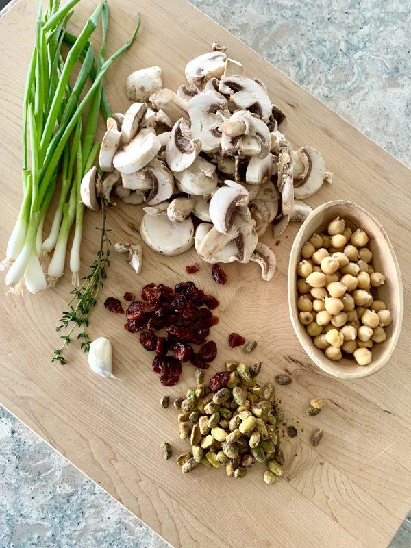Honeynut Squash Stuffed with Mushrooms, Chickpeas, Pistachios & Cranberries via LizsHealthyTable.com #vegan #vegetarian