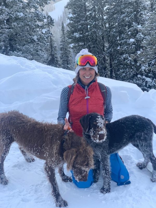 Annie Fenn walks her dogs in the Tetons