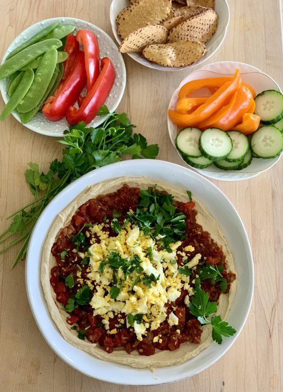 Hummus Shakshuka Snack Bowl with Veggies and Sweet Potato Chips via LizsHealthyTable.com