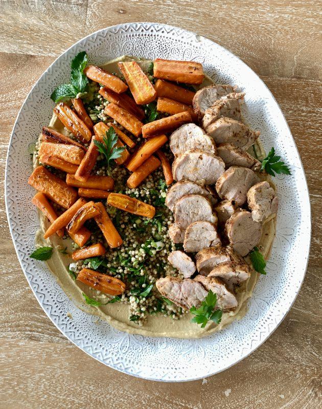Roasted Pork Tenderloin with Chickpea Hummus, Herbed Sorghum, and Cumin-Honey Carrots via lizshealthytable.com